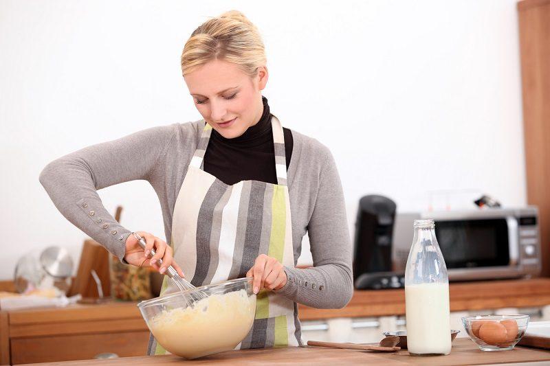 blonde-woman-making-a-cake