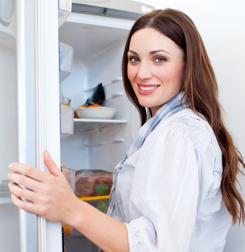 happy-woman-looking-for-something-in-the-fridge